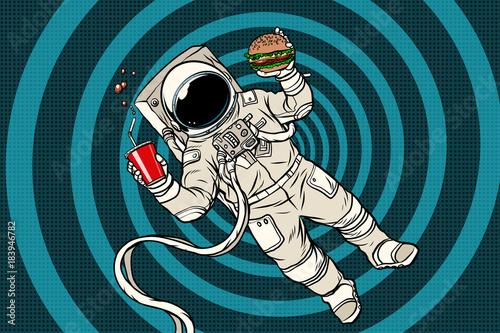 Valokuvatapetti Astronaut in zero gravity with fast food