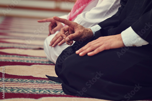 Two religious muslim man praying together inside the mosque Fotobehang