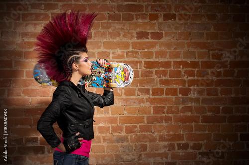 Punk girl on brick wall background Canvas Print