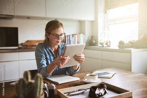 Fotografie, Obraz  Young woman working from home with a digital tablet