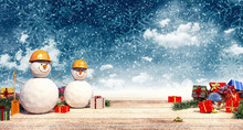 Two Snowman Workers With Prese...