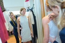 Fashion Designer Fitting A Model