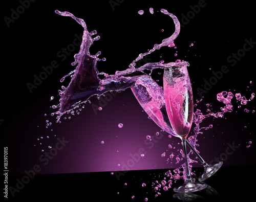 Fényképezés  pink champagne splash on a black background