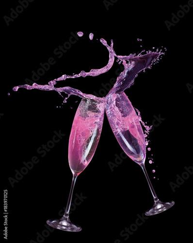 Fényképezés  pink champagne splash in glass on a black background