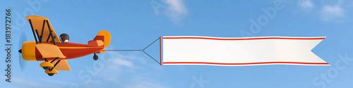 Flieger mit Banner Wolkenhimmel Canvas Print