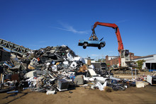 Recycle Cars  And Trucks Being Tossed To To Scrap Heap
