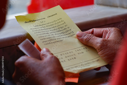 Photo  Phuket, Thailand - September 11, 2016- : Predicted paper for answer of Fortune Sticks at Chalong temple or  Wat Chalong