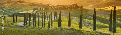 Stickers pour porte Vignoble orange sunset in Tuscany in Italy