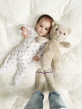 Portrait Of Baby With Teddy Be...