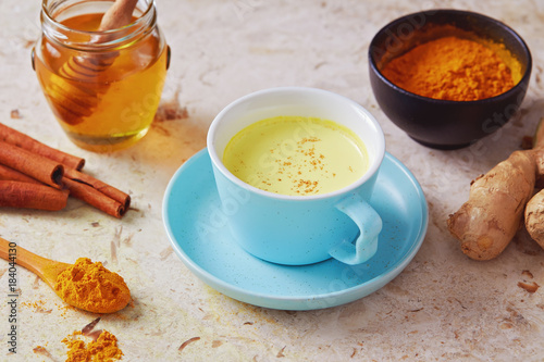 Delicious detox drink made of turmeric, ginger, milk, honey and cinnamon.