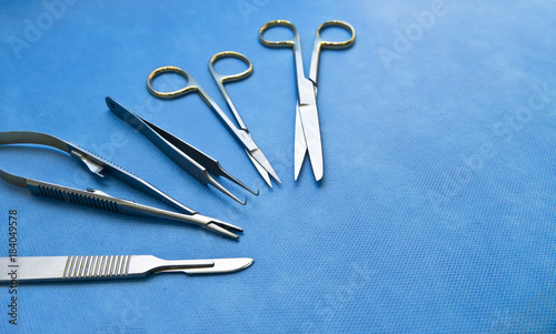 Basic surgical instruments on the sterilized blue wrap - Buy