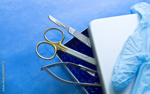 Basic surgical instruments in the sterilized blue wrap - Buy