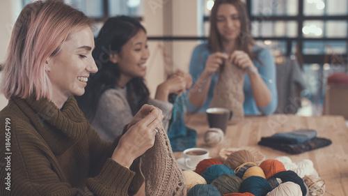Fotografie, Obraz  Girls with knitting needles
