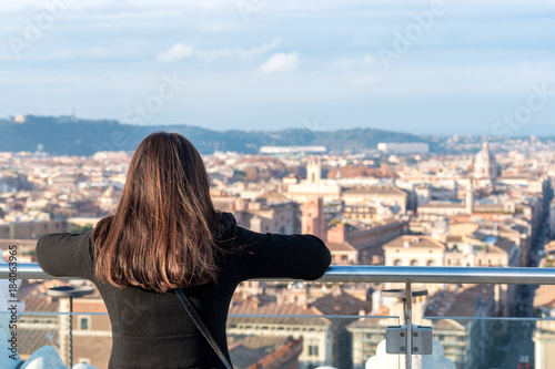 Fényképezés  Woman tourist is looking on city Rome from a high point.