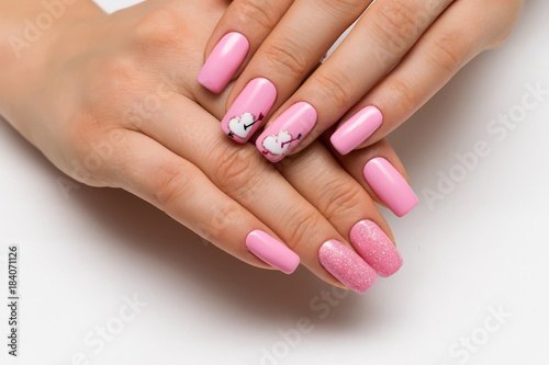 Aluminium Prints Manicure gently pink manicure with sparkles with painted hearts and arrows on square long nails