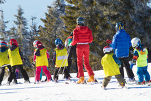 Ski Instructor Teaching Young ...