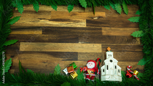 Poster Fleur Christmas frame with ornaments decoration items with small elements on the wooden background. Top view.