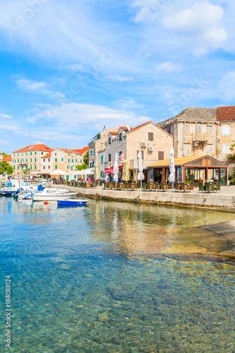 Foto op Canvas Europa POSTIRA VILLAGE, BRAC ISLAND - SEP 7, 2017: Restaurant buildings and houses in Postira port, Brac island, Croatia.