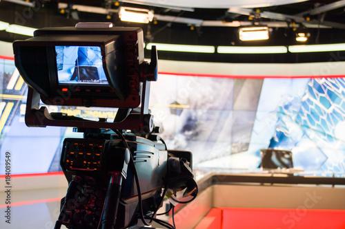 Fototapeta video camera lens recording show in tv studio focus on camera aperture