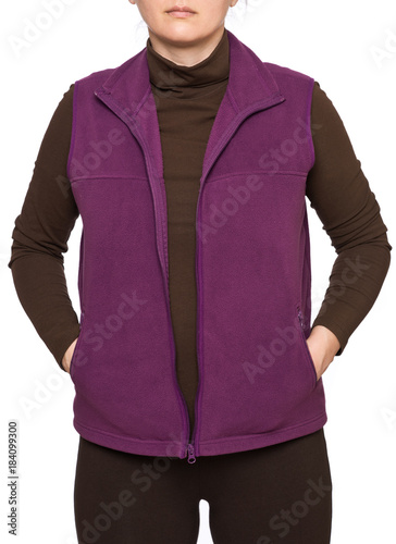 Photo  Young woman wearing purple fleece vest isolated on white background