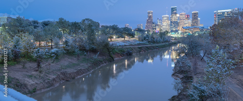 Poster Texas Panorama view unusual snowfall along Bayou River bank with downtown Houston, Texas, USA skylines city lights reflection at sunrise/twilight. Snow is extremely rarely and happen only 35 time since 1895