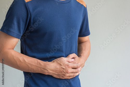 Photo man have stomachache on gray background