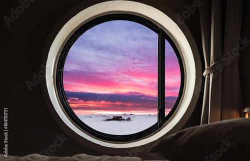 Looking through window in winter, at evening sunset Fototapeta