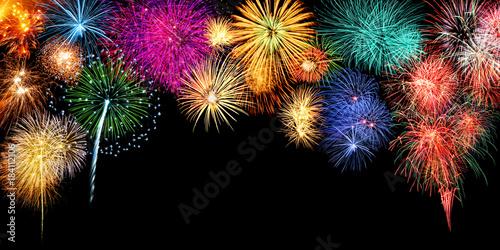 Photo  Großes Silvester Feuerwerk als Rahmen Hintergrund mit Textfreiraum