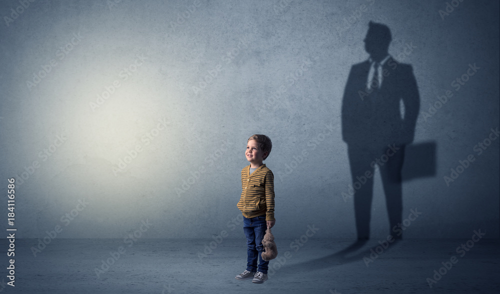 Fototapeta Little boy with businessman shadow