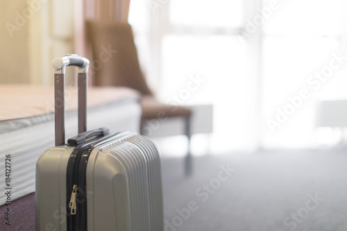 Fotografia Suitcase or luggage bag in a modern hotel room
