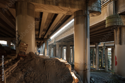 Foto op Plexiglas Chicago Light filters through and exposes the underside of a concrete freeway