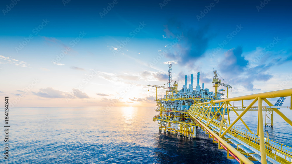 Fototapety, obrazy: Panorama of Offshore oil and gas construction platform to received raw gas and treat then sent to onshore refinery and petrochemical, Power and energy business.
