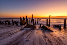 Outgoing Tide Washes Around Old Sea Defense At Spurn Point