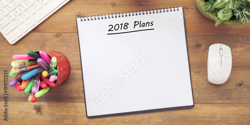 2018 plans on blank notebook paper on office wood table background banner with copy