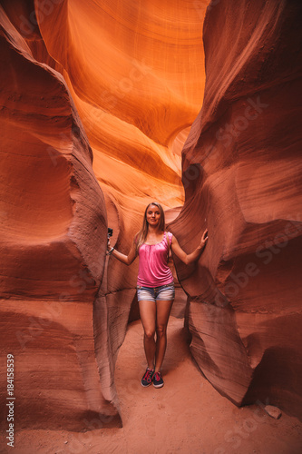 Tuinposter Bordeaux Young girl exploring Antelope Canyon in the Navajo Reservation near Page, Arizona USA