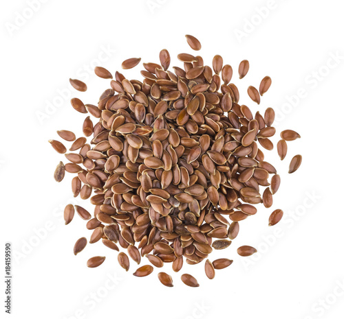 Pile of flax seeds isolated on white background close-up, top view