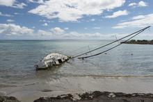 Capsized Sailboat On Guadeloupe