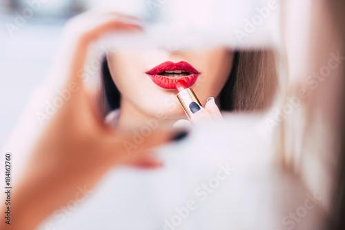 Fotografiet red lipstick makeup seductive sensual provocative sexy woman lips concept