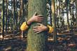 canvas print picture - Man hugging tree bark