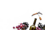 Open the wine. Corkscrew near bottle and grape on white background top view copyspace - 184167139
