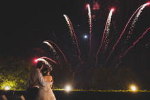 Couple Watching Fireworks At Wedding