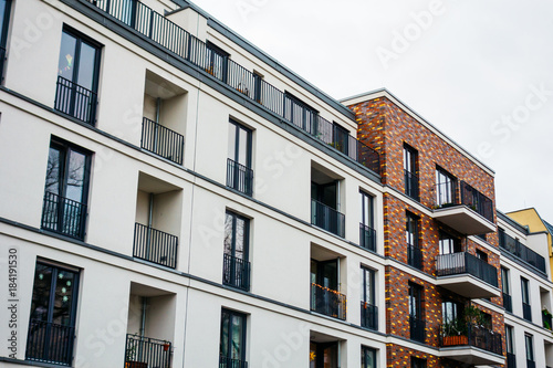 white modern apartment building with brick details in high ...