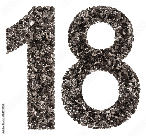 Photo Arabic numeral 18, eighteen, from black a natural charcoal, isolated on white ba