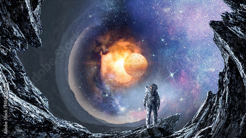 Space hole and astronaut. Mixed media фототапет