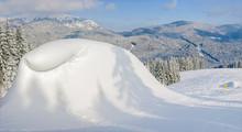 Snow-drift Beside Of Ski Piste On Background Of Mountain