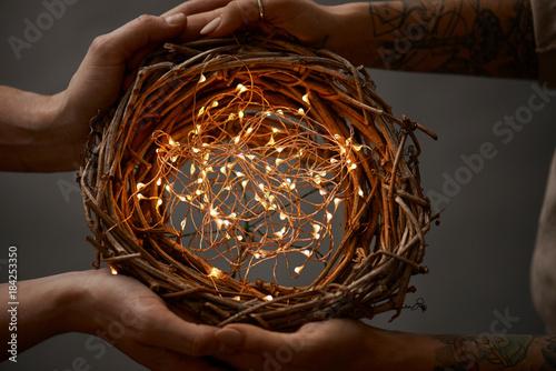 Obraz na plátně  wreath of twigs and Christmas lights