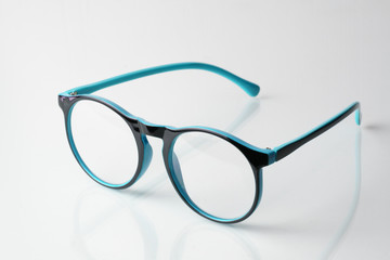 Blue glasses on a white background.