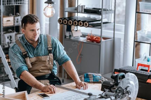 Fotografie, Obraz  Worker proud of renovation plan