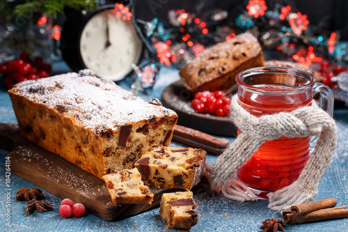 Aluminium Prints Old abandoned buildings Traditional Christmas cake with fruits and nuts in festive decoration