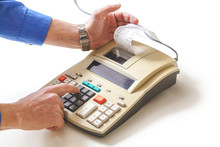Hand Presses Cash Register Key...